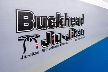 buckhead jiu jitsu written on wall mats