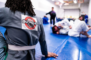 people training with buckhead gi patch in foreground
