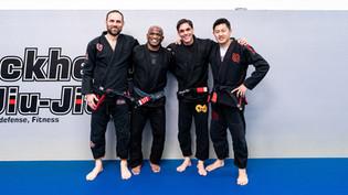 buckhead black belts arm in arm