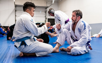 training partners fist bump before training