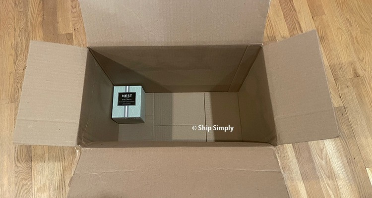 A small item in a huge box demonstrates how dim weight can affect shipping costs.