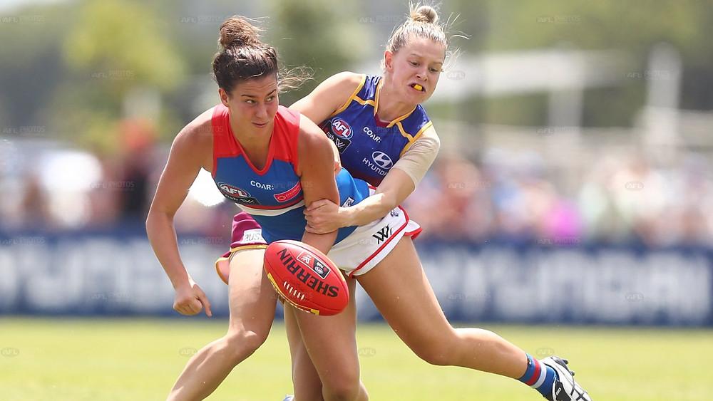 Libby Birch gets a handball away from Kate McCarthy