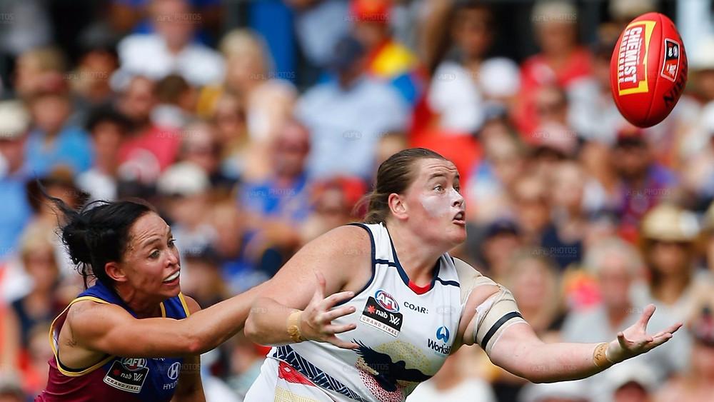 Sarah Perkins marks in front of Leah Kaslar
