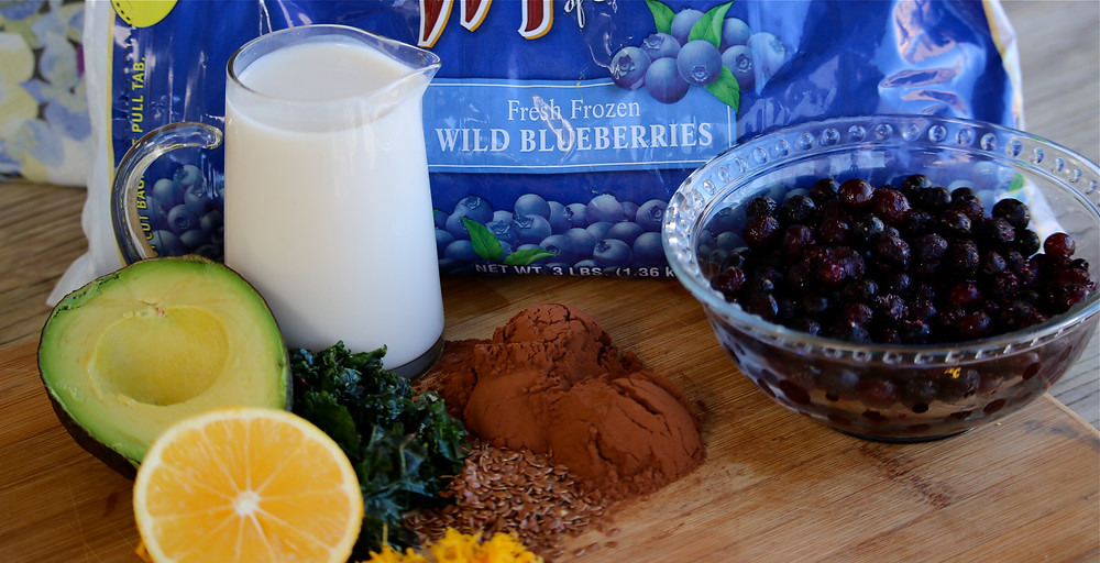 Wild Blueberries, Almond Coconut Blend Milk, Baking Cocoa Powder, Orange Juice, Lemons, Flax, Kale and Avocados create a decadent healthy smoothie!