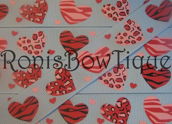ZEBRA LEOPARD PRINT HEARTS ON LIGHT BLUE