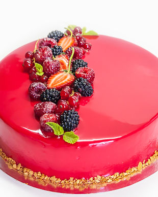 Modern mousse cake with red glaze and be