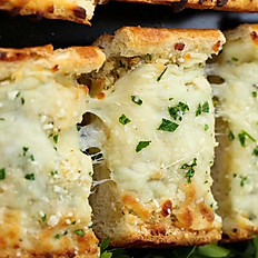 GARLIC BREAD WITH MELTED MOZZARELLA