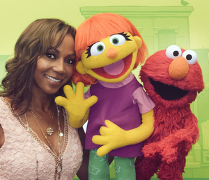 Actress Holly Robinson Peete with Julia and Elmo (Twitter).