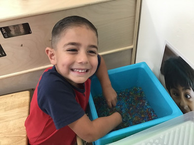 happy_child_playing_in_preschool.jpeg