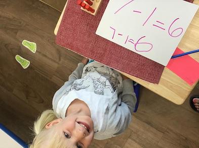 happy_child_learning_math.jpeg