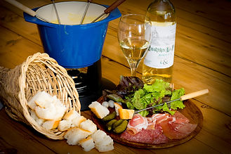 Delicious fondue dinner of specialty meats, cured cheese fondue and chocolate fondue dessert in Rossland, B.C