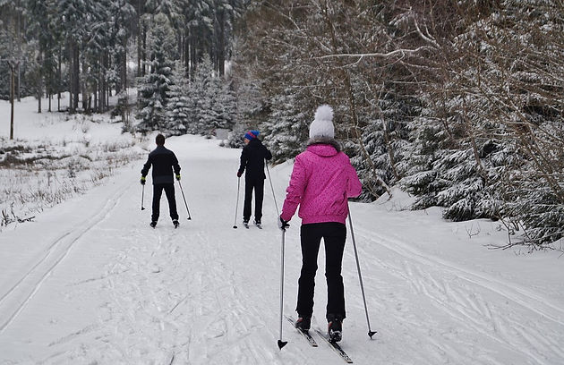 Snow mountain, a group cross country skiing along an easy skiing track in winter in Rossland, B.C