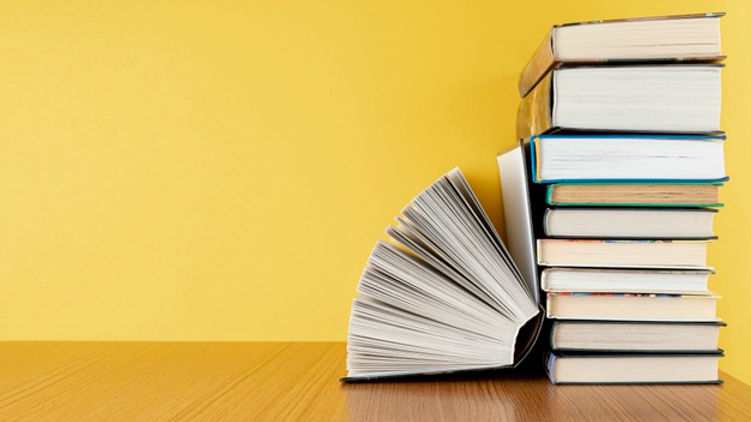 front-view-pile-books-with-copy-space_23