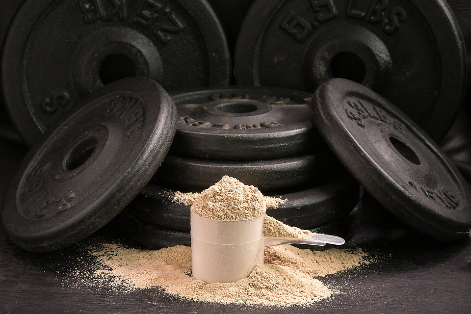 whey protein with iron plates.jpg