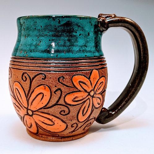 Orange and turquoise floral mug