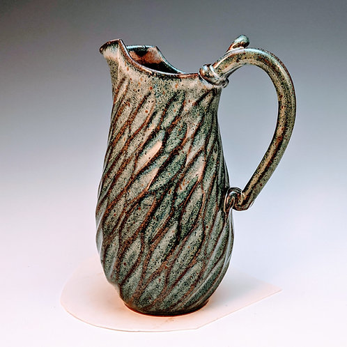 Carved pitcher