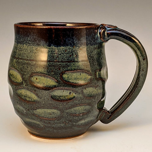 Carved mug in magic green