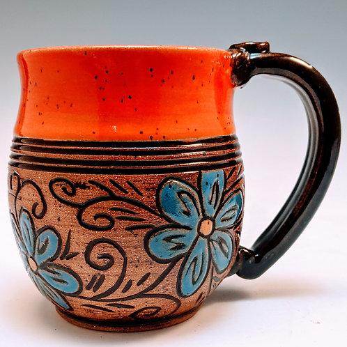 Orange and blue floral mug