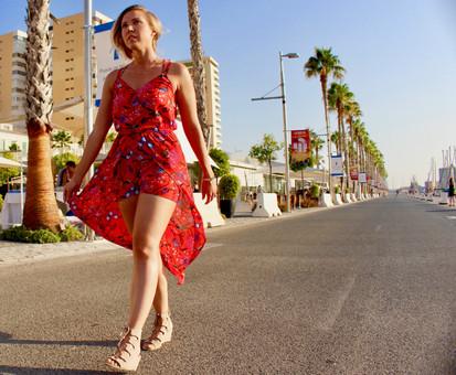 A woman in red waliking in Malaga