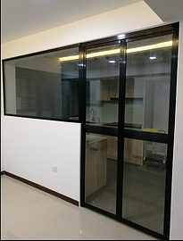 black colour bifold door with glass panel for open concept kitchen in HDB flat
