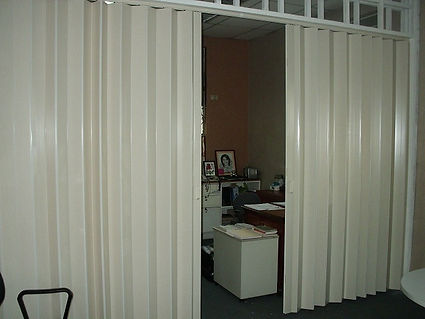 White folding door in Singapore office