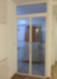 kitchen bifold door for tall ceiling | top fixed panel above kitchen entrance bifold door