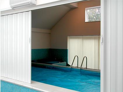 White folding door in Singapre Indoo swimming pool
