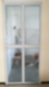 kitchen entrance bifold door singaore install in HDB flat | white frame with clear acrylic panel