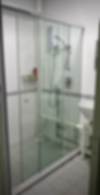 shower glass panel in Singapore that require hole to be cut to accomodate piping