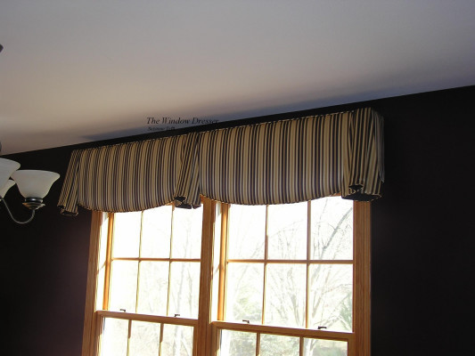 Cornice board with added horns