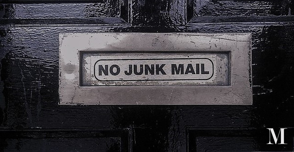 Letterbox with sign saying 'no junk mail'