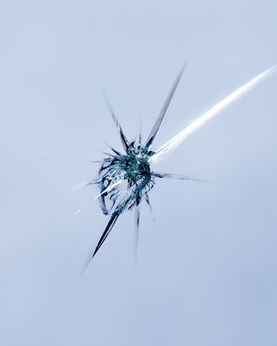 Closeup of cracked windshield with fissu