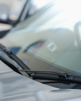 close up of car windshield rain wipers A