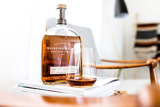 A bourbon bottle and tasting glass