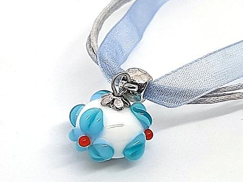 Pendentif fleur bleue pour fillette