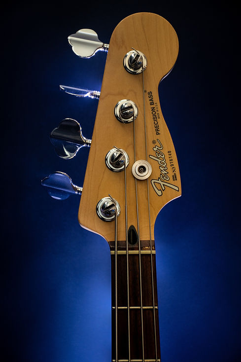 close-up-photography-of-brown-fender-gui