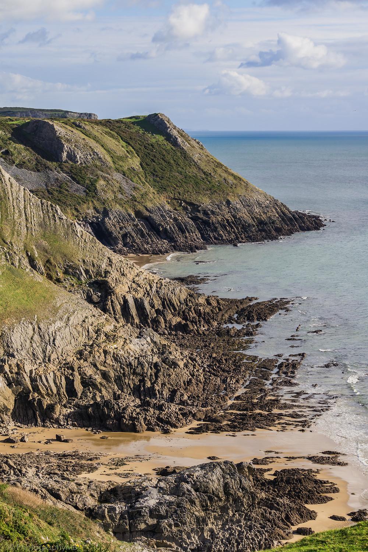 Dramatic cliffs at Pennard on trail down to Three Cliffs