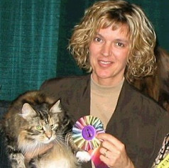 me at a cat show with Gracelett 1999(?)