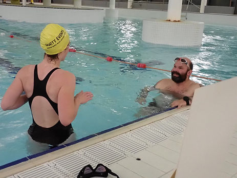 Small group coaching session in a swimming pool in Aviemore, Scotland