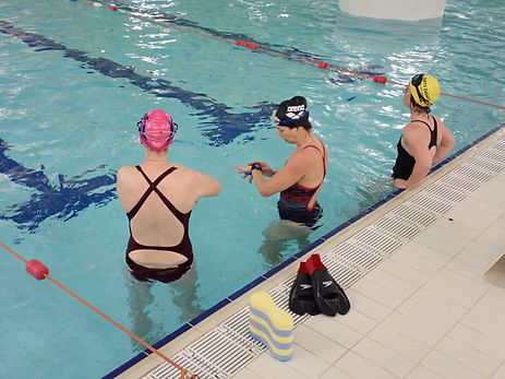 Swimmers in swimming pool attending a stroke clinic in Aviemore in Scotland