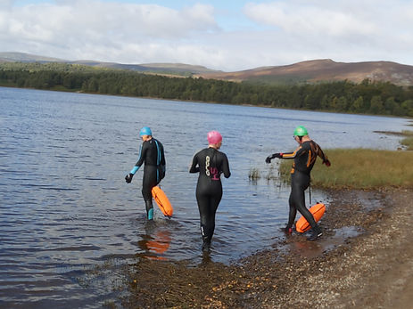 Small group coaching session in open water near Aviemore in Scotland