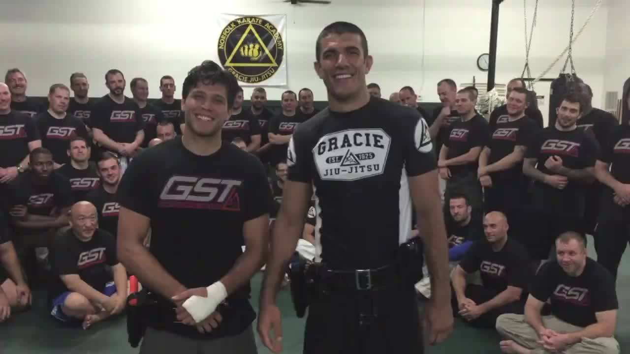July 2015 Gracie Breakdown: In a video that wen't viral a few weeks ago, a man in the UK is seen overpowering two police officers and pinning them to the ground while strangling both of them simultaneously before he flees.