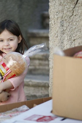 Young girl with a life-saving loaf of bread