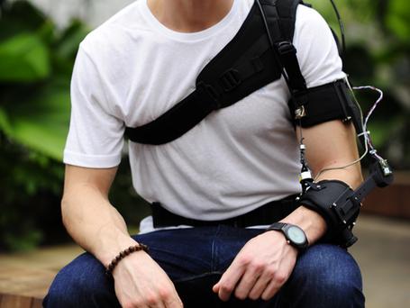 Soft robotic elbow suit