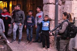 Children watch the scene of a terrorist attack in Jerusalem, March 2018
