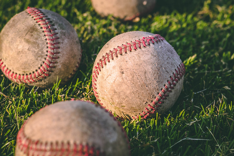 close-up-photography-of-four-baseballs-o