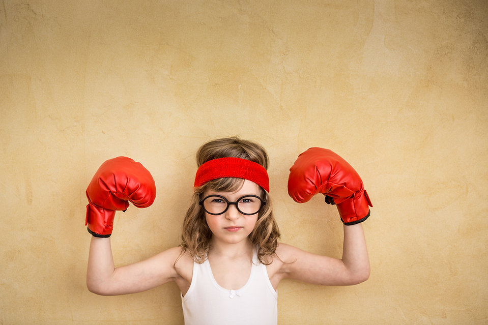 Funny strong child. Girl power and femin