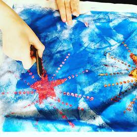 Kids painting on tea towels workshop