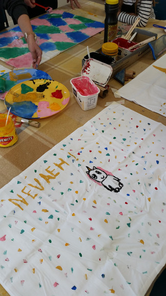 Kids painting on tea towels workshop
