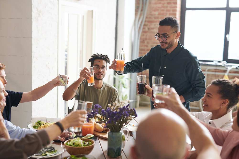 Mental Health After Covid | Friends gather together for dinner